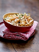 Bowl of sliced chicken breast with sesame seeds and rice with shrimps