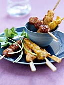 Spicy chicken and beef brochettes