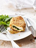Chicken breast stuffed with herbs and cooked in breadcrumbs