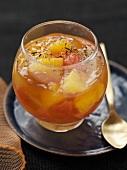 Citrus fruit in tea-flavored jelly