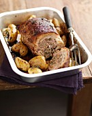 Roast stuffed veal's breast with potatoes
