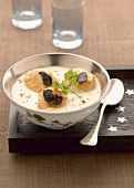 Cream of cauliflower soup with scallops and truffles