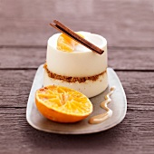 Panacotta with gingerbread, orange and cinnamon sauce