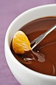 Chocolate cream dessert with clementine