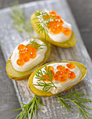 Ratte potatoes with cream and salmon roe