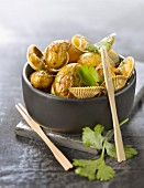 Roast ratte potatoes with cockles and coriander