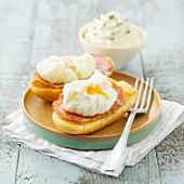 Benedict eggs and bacon on toasted milk breads ,whipped cream with chives