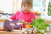 Young girl preparing vegetables