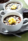 Chocolate cream dessert with almonds,pineapple and coconut