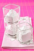 Small glass pots of icing sugar