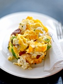 Scrambled eggs with peppers and ham