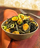 Squid ink spaghettis with mussels and saffron