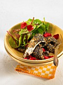 Sole fillets coated in sesame and poppyseeds, beetroot shoot and poppy salad
