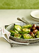 Mini cabbages with sage butter,walnuts,cumin seeds and mini sausages rolled in bacon