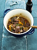 Wild boar stew with beer and mushrooms
