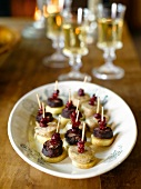 Apple,blood sausage and cranberry canapés