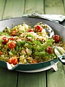 Quinoa with cherry tomatoes,celery stalks,thinly sliced almonds and dill
