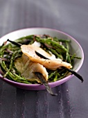 Bass with vanilla on a bed of green seaweed