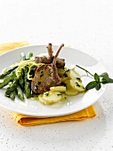 Lamb chops with potatoes and green asparagus with herbs