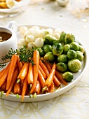 Carrots,brussels sprouts and onions caramelized in maple syrup