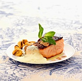 Thick piece of salmon with curried coconut milk emulsion