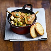 Chicken with confit citrus and olives, Breton galettes