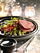 Sweet and sour beef fillet with green asparagus