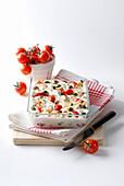 Tomato,cheese,almond and pistachio gratin
