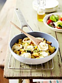 Pan-fried zucchinis and potatoes with goat's cheese