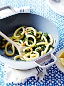 Calamaries and spinach with lemon cooked in a wok