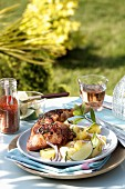Grilled chicken with spices,potato and onion salad