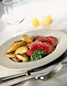 Roast beef with parsley butter and potatoes