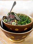 Vegetable broth with beef meatballs