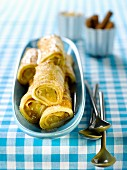 Rolled pancakes with rhubarb filling