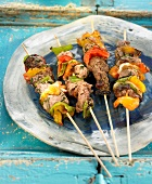 Veal and three different colored pepper brochettes
