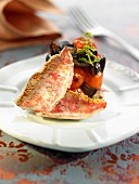 Red mullet fillets with tomatoes and black olives