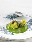 Pine nut and cabbage Botifarra with creamy spinach sauce