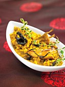 Rabbit with saffron rice and black trumpet mushrooms