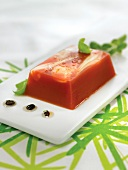 Jellied tomato terrine with black olive dressing