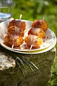 Potato brochettes coated in chorizo crumbs