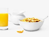 Bowl of cereals and glass of orange juice