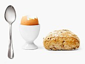 Spoon,bread and soft-boiled egg
