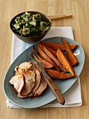 Roast pork with sweet potatoes and stewed swiss chard