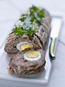 Meatloaf with hard boiled eggs in the middle
