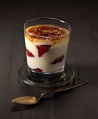 Catalane cream dessert with raspberries and caramelized topping