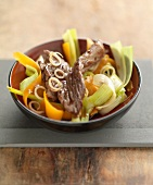Beef and vegetables cooked in a wok