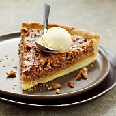 Canadian nut tart with a scoop of vanilla ice cream