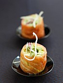Smoked salmon rolls with avocado and lemon filling