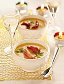 Cream of pumpkin soup with duck breast crisps