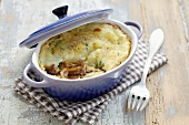 Lamb confit and coriander cheese-topped dish